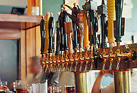 Beer pub taps at bar in microbrewery, Portland, OR. Portland Oregon.