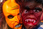 A3ABKA Two children wearing Halloween masks