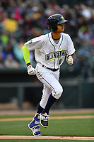 Right fielder Jose Medina (8) of the Columbia Fireflies runs toward first in a game against the Lakewood BlueClaws on Friday, May 5, 2017, at Spirit Communications Park in Columbia, South Carolina. Lakewood won, 12-2. (Tom Priddy/Four Seam Images)