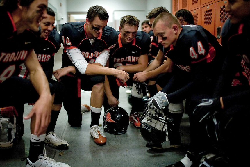 Post Falls Trojans players get ready for a local 5A football game against the East Valley Knights on Friday night in Post Falls, ID.<br /> (Matt Mills McKnight for The Spokesman-Review)