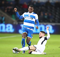 11th February 2020; Liberty Stadium, Swansea, Glamorgan, Wales; English Football League Championship, Swansea City versus Queens Park Rangers; Bright Osayi-Samuel of Queens Park Rangers is slide tackled by Matt Grimes of Swansea City