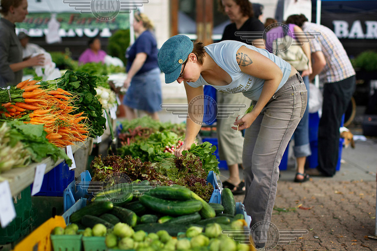 Sarah Doom works at a farmers' market on Saturday morning in Wilmington, Massachusetts.