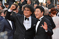 CANNES, FRANCE. May 25, 2019: Bong Joon-Ho & Song Kang-ho at the Closing Gala premiere of the 72nd Festival de Cannes.<br /> Picture: Paul Smith / Featureflash