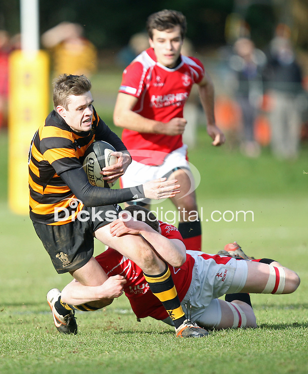 SCHOOLS CUP 2015  | Saturday 7th February 2015<br /> <br /> Callum McLaughlin makes a break and is tackled by Conn Crawford during the third round of the 2015 Ulster Schools Cup between RBAI and Regent House at Osborne Park, Belfast.<br /> <br /> Picture credit: John Dickson / DICKSONDIGITAL