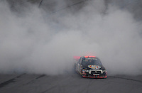 Oct. 31, 2009; Talladega, AL, USA; NASCAR Camping World Truck Series driver Kyle Busch celebrates after winning the Mountain Dew 250 at the Talladega Superspeedway. Mandatory Credit: Mark J. Rebilas-