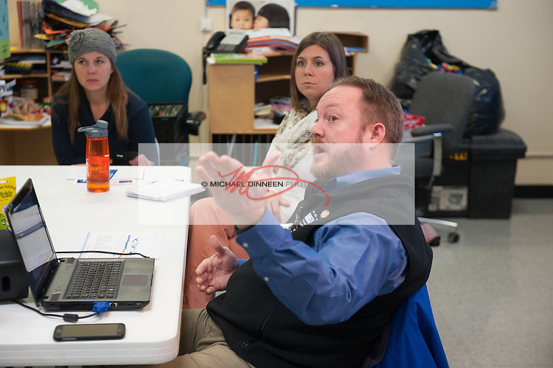 CCS Early Learning executive director Mark Lackey, right, works through his talking points Thursday, Dec. 8, 2016.  Photo for the Star by Michael Dinneen