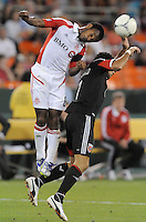 Toronto FC midfielder Julian de Guzman (6) heads the ball against D.C. United forward Dwayne de Rosario (7)  D.C. United defeated Toronto FC 3-1 at RFK Stadium, Saturday May 19, 2012.