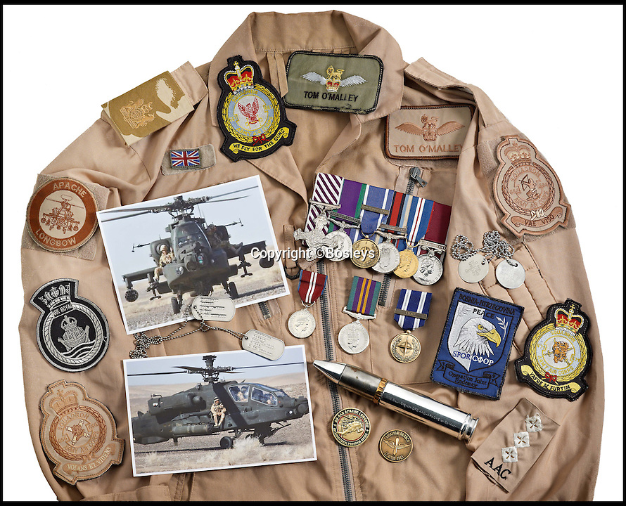 BNPS.co.uk (01202 558833)<br /> Pic: Bosleys/BNPS<br /> <br /> Sand Coloured Flying Suit that Captain Tom O'Malley would have worn into combat.<br /> <br /> A British helicopter pilot who performed one of the most daring rescues of the Afghanistan war is selling his gallantry medal to raise 100,000 pounds.<br /> <br /> Captain Tom O'Malley flew his Apache chopper into a Taliban stronghold with two Royal Marines strapped to the side in a brave bid to save a fatally wounded comrade.<br /> <br /> The pilot flew the gun ship at 60mph and just 20ft above the ground into the heavily defended Talban fort.<br /> <br /> The two marines jumped down and rescued Royal Marine Lance Corporal Mathew Ford. Tragically he could not be saved from his injuries which had been caused by friendly fire.<br /> <br /> Capt O'Malley's Distinguished Flying Cross is being sold by auctioneers Bosleys of Marlow, Bucks, tomorrow (Weds).