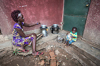 Uganda, Hoima. Irene Ahebwa (26), sells fruits and vegetables and has a son, Benjamin. At home she uses a BioLite cook stove that charges a light and mobile phone.