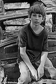 Sitting on the old derelict car in the grounds, Summerhill school, Leiston, Suffolk, UK. 1968.