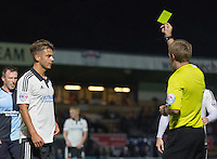 Goal scorer Alex Kacaniklic of Fulham is given a yellow card by the Referee during the Capital One Cup match between Wycombe Wanderers and Fulham at Adams Park, High Wycombe, England on 11 August 2015. Photo by Andy Rowland.