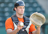 Catcher Jeff Arnold (20) of the Augusta GreenJackets, Class A affiliate of the San Francisco Giants, in a game against the Greenville Drive on April 7, 2011, at Fluor Field at the West End in Greenville, South Carolina. (Tom Priddy / Four Seam Images)