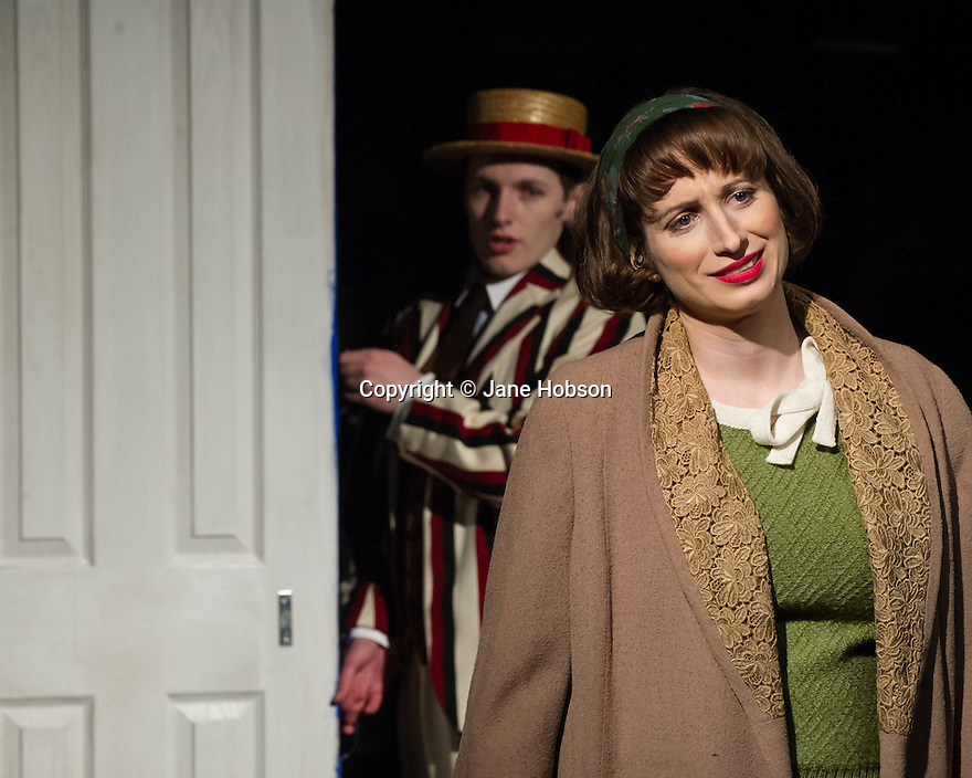 London, UK. 21.02.2014. THE A TO Z OF MRS P has its world premiere at Southwark Playhouse.  The story behind the handy, all-purpose, pocket-sized A-Z Street Guide is written by Diane Samuels (book) and Gwyneth Herbert (music and lyrics). <br />  Starring ISY SUTTIE (Peep Show / Shameless) in her first musical, as the pioneering Mrs P; with Tony Award winner FRANCES RUFFELLE (Les Miserables, Pippin, Piaf) as her emotionally fragile mother; and Olivier Award winner MICHAEL MATUS (Martin Guerre, The Baker's Wife, The Sound Of Music) as Phyllis&rsquo;s beloved and impossible father, the map publisher Sandor Gross. Directed by Sam Buntrock. Picture shows: Isy Suttie (Mrs P) with Max Gallagher behind.<br /> Photograph &copy; Jane Hobson.