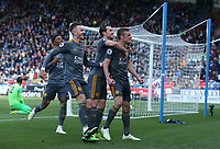 Leicester City's Jamie Vardy celebrates scoring his second and side's fourth with team-mates Ben Chilwell, James Maddison and Demarai Gray goal <br /> <br /> Photographer Stephen White/CameraSport<br /> <br /> The Premier League - Huddersfield Town v Leicester City - Saturday 6th April 2019 - John Smith's Stadium - Huddersfield<br /> <br /> World Copyright © 2019 CameraSport. All rights reserved. 43 Linden Ave. Countesthorpe. Leicester. England. LE8 5PG - Tel: +44 (0) 116 277 4147 - admin@camerasport.com - www.camerasport.com