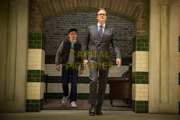 Taron Egerton, Colin Firth<br /> in Kingsman: The Secret Service (2014) <br /> *Filmstill - Editorial Use Only*<br /> CAP/FB<br /> Image supplied by Capital Pictures