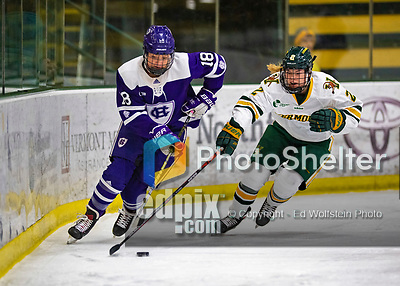 2 February 2020: Holy Cross Crusader Forward Rachel Moore, a Senior from Falmouth, MA, and University of Vermont Catamount Defender Sini Karjalainen, a Sophomore from Posio, Finland, battle for possession during first period NCAA Women's Hockey action at Gutterson Fieldhouse in Burlington, Vermont. The Lady Cats rallied in the 3rd period to tie the Crusaders 2-2 in NCAA Women's Hockey East play. Mandatory Credit: Ed Wolfstein Photo *** RAW (NEF) Image File Available ***