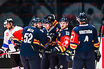 Stockholm 2015-09-04 Ishockey CHL Djurg&aring;rdens IF - EV Zug :  <br /> Djurg&aring;rdens David Rundqvist gratuleras av lagkamrater Mikael Ahl&eacute;n och Linus Hultstr&ouml;m efter sitt 1-0 m&aring;l under matchen mellan Djurg&aring;rdens IF och EV Zug <br /> (Foto: Kenta J&ouml;nsson) Nyckelord:  Ishockey Hockey CHL Hovet Johanneshovs Isstadion Djurg&aring;rden DIF Zug jubel gl&auml;dje lycka glad happy