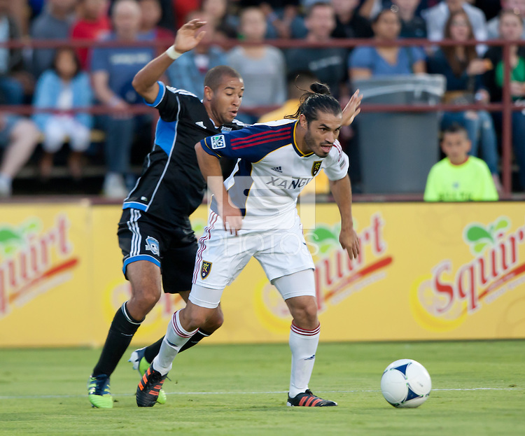 Santa Clara, California - Saturday July 14, 2012: Real Salt Lake's Fabian Espindola and San Jose Earthquakes' Justin Morrow in action during a game at Buck Shaw Stadium, Stanford, Ca     San Jose Earthquakes defeated Real Salt Lake 5 - 0