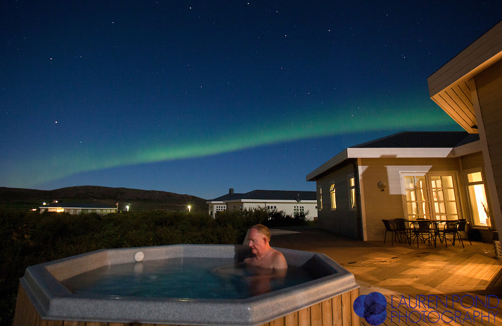 Soaking in a hot tub under the Northern Lights.
