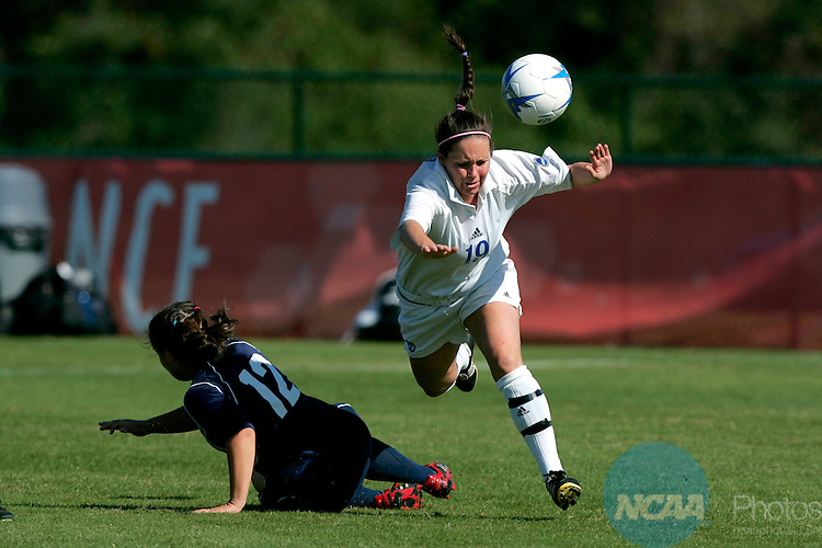 18 November 2006: Grand Valley State's Erica Rose (white) and Metro State's Vanessa Mais battle for possesion of the ball during the 2006 NCAA Division II Women's Soccer Championship held at Escambia County Stadium in Pensacola, FL.  Metro defeated Grand Valley State 1-0 in overtime to take home their second title in three years.  The championship was part of the Division II Sports Festival in Pensacola. Trevor Brown, Jr./NCAA Photos.