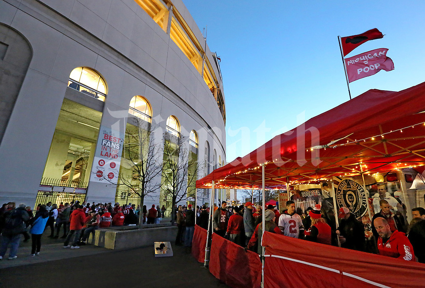 Tailgaters enjoy the nice weather before the start of an evening  NCAA football game between the Ohio State Buckeyes and the Minnesota Golden Gophers at Ohio Stadium on Saturday, November 7, 2015. (Columbus Dispatch photo by Fred Squillante)
