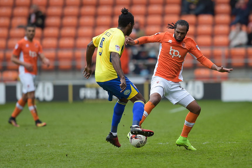 Accrington Stanley's Omar Beckles is tackled by Blackpool's Andy Taylor<br /> <br /> Photographer Terry Donnelly/CameraSport<br /> <br /> The EFL Sky Bet League Two - Blackpool v Accrington Stanley - Friday 14th April 2017 - Bloomfield Road - Blackpool<br /> <br /> World Copyright &copy; 2017 CameraSport. All rights reserved. 43 Linden Ave. Countesthorpe. Leicester. England. LE8 5PG - Tel: +44 (0) 116 277 4147 - admin@camerasport.com - www.camerasport.com