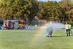 04.09.2018, Hoheellern-Stadion, Leer, GER, FSP, Werder Bremen (GER) vs FC Emmen (NED)<br /> <br /> DFL REGULATIONS PROHIBIT ANY USE OF PHOTOGRAPHS AS IMAGE SEQUENCES AND/OR QUASI-VIDEO.<br /> <br /> im Bild / picture shows<br /> Einsatzkräfte der Feuerwehr Leer bewässern den Rasen vor Aufwärmen der Mannschaften, <br /> <br /> Foto © nordphoto / Ewert