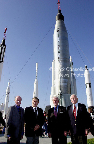 Four space pioneers pose for a photo in the Rocket Garden at the Kennedy Space Center (KSC) at Cape Canaveral, Florida Visitor Complex. From left are Gordon Cooper, Wally Schirra, Scott Carpenter and John Glenn Jr. The occasion was the celebration of the 40th anniversary of American spaceflight. The event was held February 24, 2002.  .Credit: NASA via CNP