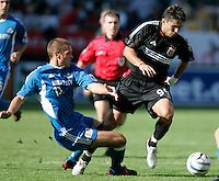 D.C. United's Jaimie Moreno slips past a sliding Kansas City Wizards' Jimmy Conrad during a 3-2 vicoty by D.C. United at the MLS Cup, at the Home Depot Center, in Carson, Calif., Sunday, Oct. 14, 2004.