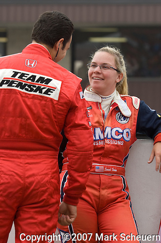5 August 2007: Helio Castroneves (BRA) and Sarah Fisher (USA) chat during pre-race ceremonies at the Firestone Indy 400, Michigan International Speedway, Brooklyn, Michigan