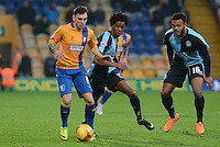 Mansfield Town's Nathan Thomas is tracked by Wycombe Wanderers Sido Jombati & Aaron Amadi-Holloway during the Sky Bet League 2 match between Mansfield Town and Wycombe Wanderers at the One Call Stadium, Mansfield, England on 31 October 2015. Photo by Garry Griffiths.