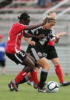 BOYDS, MARYLAND - July 21, 2012:  Hayley Siegel (12) of DC United Women pushes away from Stephanie Goddard (21) of the Virginia Beach Piranhas during a W League Eastern Conference Championship semi final match at Maryland Soccerplex, in Boyds, Maryland on July 21. DC United Women won 3-0.