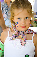 Young girl with face paints and broken arm. Svenskarnas Dag Swedish Heritage Day Minnehaha Park Minneapolis Minnesota USA
