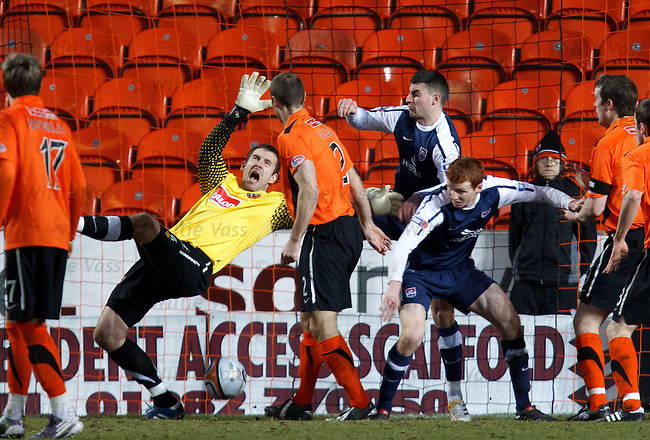 Ross County have the ball in the net but it is ruled off for a foul on keeper Dusan Pernis