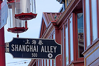 Shanghai Alley street sign with Sam Kee Building in background, Chinatown, Vancouver, BC, Canada