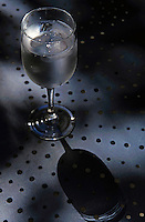 Wine glass full of iced water.
