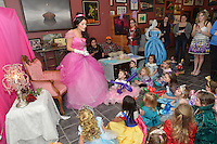 Kira Jade Roebuck, a character princess at The Painted Cat tells a fairy tale to children attending the princess make-up party. Kira is a professional actress, model and performer.