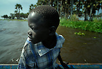 A boy in a boat on the Upper Nile River in Malakal, Southern Sudan. NOTE: In July 2011 Southern Sudan became the independent country of South Sudan.