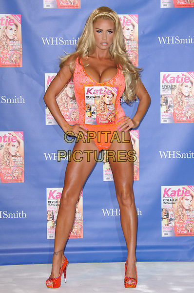 Katie Price aka Jordan launches her new magazine Katie: My Magazine, The Worx Studios, London, England..7th September 2011.full length orange platform peep toe shoes leotard peach hands on hips cleavage .CAP/CJ.©Chris Joseph/Capital Pictures.