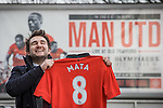© Joel Goodman - 07973 332324 . 27/01/2014 . Manchester , UK . ANDY LEATHLEY (28) (correct) from Chorlton poses with his new shirt in front of an ad board in front of Old Trafford . Fans with new MATA 8 shirts in front of Old Trafford Football Ground as it's announced that Spaniard Juan Mata ( Juan Manuel Mata García ) has signed for Manchester United  . Photo credit : Joel Goodman