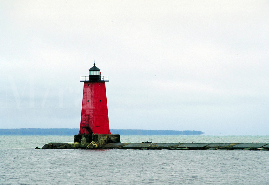 Lighthouse at entrance to Manistique Harbor and Manistique River. Manistique Michigan USA Lake Michigan.