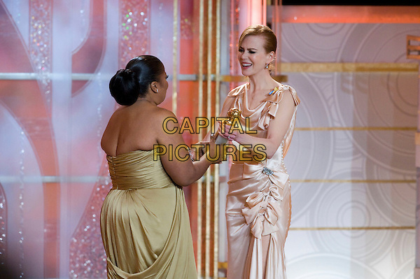 "MO'NIQUE (Monique Imes) & NICOLE KIDMAN.Accepts the Golden Globe Award for BEST PERFORMANCE BY AN ACTRESS IN A SUPPORTING ROLE IN A MOTION PICTURE for her role in ""Precious: Based On The Novel Push By Sapphire"" at the 67th Annual Golden Globe Awards at the Beverly Hilton in Beverly Hills, CA, USA..January 17th, 2010.                               .globes stage half length dress strapless khaki gold green olive gown award trophy winner peach silk satin dress sleeveless beige bows ruched .CAP/AW/HFPA.Supplied by Anita Weber/Capital Pictures"