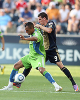 Sebastien Le Toux #9 of the Philadelphia Union pushes up on Tyrone Marshall #14 of the Seattle Sounders FC during the first MLS match at PPL stadium in Chester, Pa. on June 27 2010. Union won 3-2.