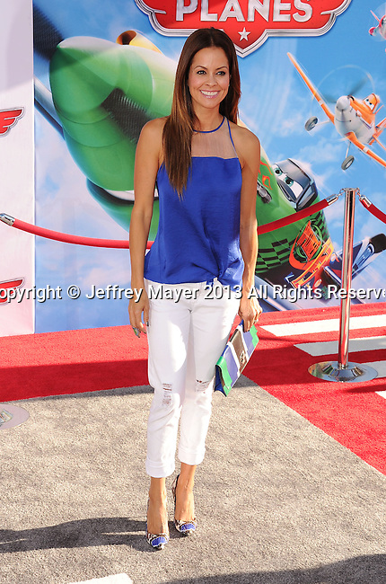 HOLLYWOOD, CA- AUGUST 05: TV personality Brooke Burke Charvet arrives at the Los Angeles premiere of 'Planes' at the El Capitan Theatre on August 5, 2013 in Hollywood, California.