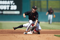 Adam Hall (10) of the Delmarva Shorebirds fields a throw as Ian Dawkins (8) of the Kannapolis Intimidators steals second base at Kannapolis Intimidators Stadium on May 19, 2019 in Kannapolis, North Carolina. The Shorebirds defeated the Intimidators 9-3. (Brian Westerholt/Four Seam Images)