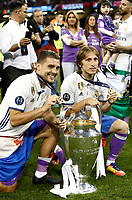 Calcio, Champions League: finale Juventus vs Real Madrid. Cardiff, Millennium Stadium, 3 giugno 2017.<br /> Real Madrid's Mateo Kovacic, left, and Luka Modric pose with the trophy at the end of the Champions League final match between Juventus and Real Madrid at Cardiff's Millennium Stadium, Wales, June 3, 2017. Real Madrid won 4-1.<br /> UPDATE IMAGES PRESS/Isabella Bonotto