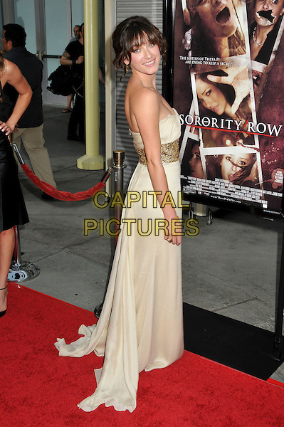 "MARGOT HARSHMAN  .""Sorority Row"" Los Angeles Premiere held at Arclight Cinemas, Hollywood, California, USA, 3rd September 2009..full length strapless cream beige gold dress long maxi waistband empire looking back over shoulder .CAP/ADM/BP.©Byron Purvis/Admedia/Capital Pictures"