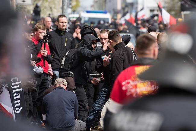 Ca. 1000 Nazis aus ganz Deutschland marschierten am Sonntag den 1. Mai 2016 im Saeschsichen Plauen auf. Die Naziorganisation 3.Weg hatte den Marsch angemeldet. Etliche Nazis waren dabei vermummt und zeigten auch den Hitlergruss, die Polizei schritt jedoch nicht ein.<br /> Nach der Haelfte der Marschroute beendeten die Nazis ihre Demonstration, da die Polizei die Marschroute verkuerzen wollte. Sie forderten die Polizei auf den Weg freizugeben. Danach griffen Aufmarschteilnehmer die Polizei an, die daraufhin Wasserwerfer, Pfefferspray, Traenengas und Schlagstoecke einsetzte. Mehrere Gruppen Nazis zogen danach durch Plauen und jagten Menschen.<br /> Nach einer Stunde bekamen die Nazis einen erneuten Aufmarsch von der Polizei genehmigt und zogen zurueck zum Bahnhof.<br /> Im Bild: Unbekannte haben 3 Steine in die Nazidemonstration geworfen und eine Person dabei am Kopf verletzt. Sie wurde von Mitdemonstranten und Polizei verarztet.<br /> 1.5.2016, Plauen<br /> Copyright: Christian-Ditsch.de<br /> [Inhaltsveraendernde Manipulation des Fotos nur nach ausdruecklicher Genehmigung des Fotografen. Vereinbarungen ueber Abtretung von Persoenlichkeitsrechten/Model Release der abgebildeten Person/Personen liegen nicht vor. NO MODEL RELEASE! Nur fuer Redaktionelle Zwecke. Don't publish without copyright Christian-Ditsch.de, Veroeffentlichung nur mit Fotografennennung, sowie gegen Honorar, MwSt. und Beleg. Konto: I N G - D i B a, IBAN DE58500105175400192269, BIC INGDDEFFXXX, Kontakt: post@christian-ditsch.de<br /> Bei der Bearbeitung der Dateiinformationen darf die Urheberkennzeichnung in den EXIF- und  IPTC-Daten nicht entfernt werden, diese sind in digitalen Medien nach &sect;95c UrhG rechtlich geschuetzt. Der Urhebervermerk wird gemaess &sect;13 UrhG verlangt.]
