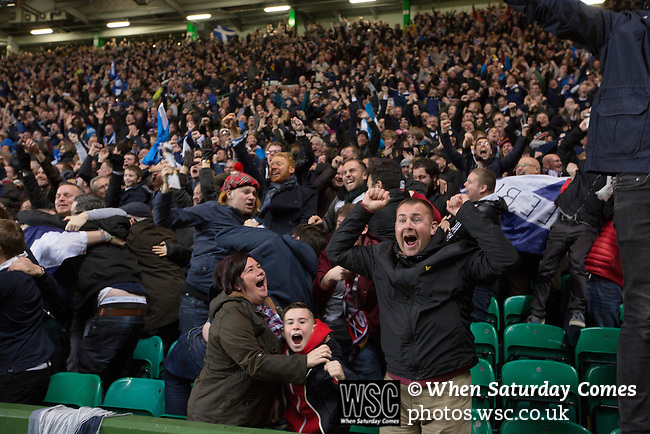 Scotland 1 Republic of Ireland 0, 14/11/2014. Celtic Park, European Championship qualifying. Home supporters reacting with delight as their team take the lead during the second-half of the European Championship qualifying match between Scotland and the Republic of Ireland at Celtic Park, Glasgow. Scotland won the match by one goal to nil, scored by Shaun Maloney 16 minutes from time. The match was watched by 55,000 at Celtic Park, the venue chosen to host the match due to Hampden Park's unavailability following the 2014 Commonwealth Games. Photo by Colin McPherson.