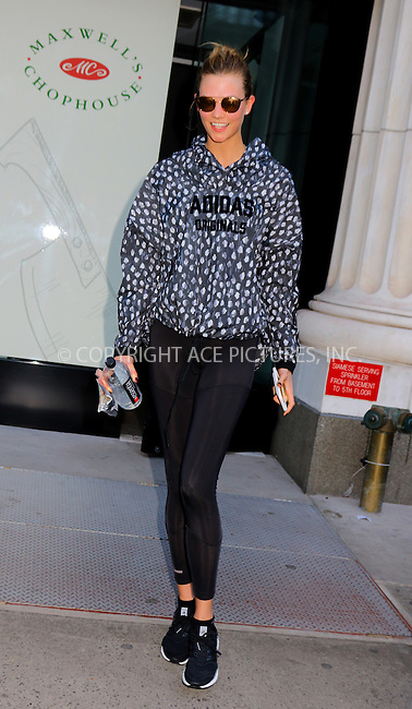 WWW.ACEPIXS.COM<br /> <br /> April 20 2016, New York City<br /> <br /> Model Karlie Kloss leaves a midtown gym on April 20 2016 in NewnYork City<br /> <br /> By Line: Philip Vaughan/ACE Pictures<br /> <br /> ACE Pictures, Inc.<br /> tel: 646 769 0430<br /> Email: info@acepixs.com<br /> www.acepixs.com